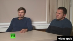 Russia - Two men identified as Aleksandr Petrov and Ruslan Boshirov appeared on Russia Today (RT) to discuss charges in Britain that they were involved in Novichok poisoning - screen grab