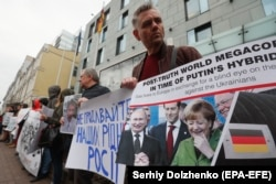UKRAINE -- Relatives of Ukrainians who were captured and sentenced by Russia, hold placards with their portraits during a rally in front of German embassy in Kyiv, April 11, 2019