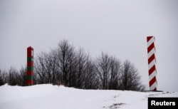 Poland -- Polish and Russian border signs are seen on the border with Russia in Zytkiejmy, February 9, 2017