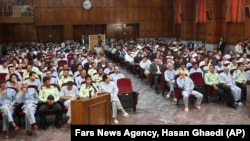 This photo released by the semi-official Iranian Fars News Agency, shows a general view of the court room where dozens of opposition activists and protesters stood trial in Tehran's Revolutionary Court on Tuesday, August 25, 2009.