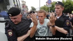 RUSSIA --Policemen detain Russian opposition leader Aleksei Navalny during a rally in support of investigative journalist Ivan Golunov, who was detained by police, accused of drug offense and later freed from house arrest, in Moscow, June 12, 2019.
