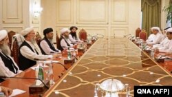 Mutlaq bin Majid al-Qahtani (R), special envoy of of the Qatari Foreign Minister for counterterrorism and mediation in conflict resolution, meets with members of Taliban's peace negotiation team in Doha, June 9, 2021.