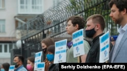 Protesters hold banners with the names of missing Crimean activists during a protest in front of the Russian Embassy in Kyiv, May 26, 2021.