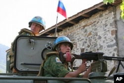 GEORGIA - Russian 'peacekeepers' sit atop their armored vehicle, in an undisclosed location in the breakaway Georgian region of Abkhazia on Tuesday, August 26, 2008
