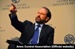 Washington, DC -- Daryl G. Kimball (left), Executive Director at the Arms Control Association, takes questions from the audience, in United States Institute of Peace on Monday, Sept. 15, 2014.