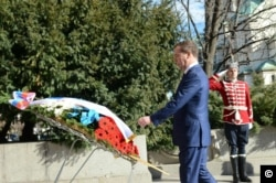 Russian Prime Minister Dmitry Medvedev lays a wreath at the Monument to the Unknown Soldier in Sofia