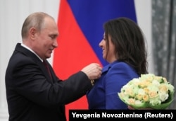 RUSSIA -- Russian President Vladimir Putin decorates editor-in-chief of Russian broadcaster RT Margarita Simonyan with the Order of Aleksandr Nevsky during an awarding ceremony at the Kremlin in Moscow, May 23, 2019