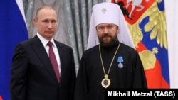 RUSSIA – Russia's President Vladimir Putin (L) awards Metropolitan Hilarion of Volokolamsk with an Order of Honor during a ceremony at the Moscow Kremlin, September 22, 2016.