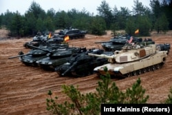 Latvia October - U.S., German, Spanish and Polish troops of the NATO enhanced Forward Presence battle goups with their tanks get ready for the Iron Tomahawk exercise in Adazi