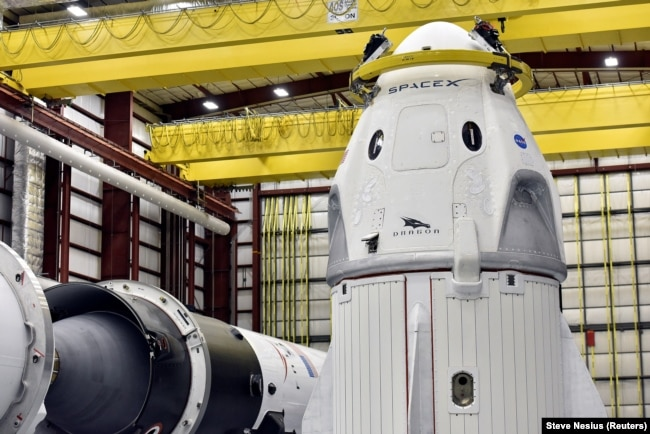 U.S. -- The Dragon crew capsule sits in the SpaceX hangar at Launch Complex 39-A, where the space ship and Falcon 9 booster rocket are being prepared for a January 2019 launch at Cape Canaveral, Florida, December 18, 2018