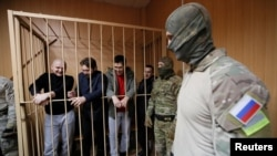 Some of the 24 Ukrainian sailors who were captured by Russia last November appearing in Lefortovo court, Moscow, Russia on January 15, 2019.
