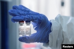 A handout photo provided by the Russian Direct Investment Fund (RDIF) shows samples of a vaccine against the coronavirus disease (COVID-19) developed by the Gamaleya Research Institute of Epidemiology and Microbiology, in Moscow, Russia August 6, 2020.