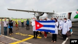 MARTINIQUE – Delegation of Cuban doctors arrive at the Martinique-Aime-Cesaire airport in Le Lamentin, near Fort-de-France, on the French Caribbean island of Martinique, as part of a medical assistance programme amid the COVID-19 pandemic. Photo taken on on June 26, 2020.