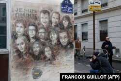"The artwork of French street artist Christian Guemy aka ""C215"" depicting members of satirical magazine Charlie Hebdo is painted on a facade near the magazine's offices at Rue Nicolas Appert, on Jan. 7, 2020 in Paris."