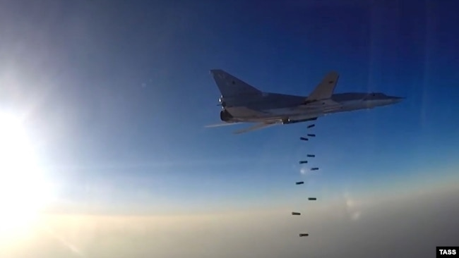 Syria - A Russian Tupolev Tu-22M3 long-range bomber drops off bombs at an unknown location in Syria, August 11, 2016