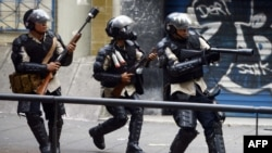 National Police members during clashes in an anti-government protest in Caracas, on March 22, 2014.