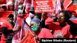 Members of The National Education, Health and Allied Workers' Union (NEHAWU) hold placards during a picket outside the Union building, as COVID-19 lockdown regulations ease in Pretoria, South Africa, September 3, 2020.