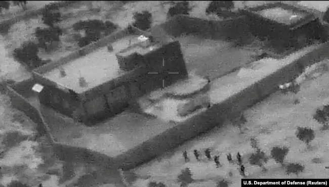 SYRIA -- U.S. special forces move towards the compound of Islamic State leader Abu Bakr al-Baghdadi during a raid in the Idlib region of Syria in a still image from video October 26, 2019