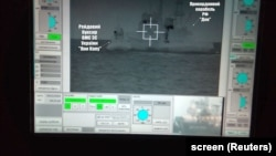 UKRAINE – A screen shows a Russian border guard vessel trying to stop a Ukrainian Navy tug boat as three Ukrainian ships make a journey from the Black Sea port of Odessa via the Kerch Strait to Mariupol on the Sea of Azov. 25Nov2018