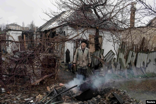 Ukraine -- A man stands in front of his destroyed house in the town of Debaltseve, north-east from Donetsk, March 13, 2015