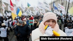 Demonstrators attend a rally of entrepreneurs and representatives of small businesses in Kyiv, Ukraine, on December 15, 2020. Entrepreneurs gathered to demand governmental support and to protest against restrictive measures introduced to curb the spread of the coronavirus.