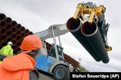 GERMANY -- Steel pipes for the North Stream 2 pipeline are uploaded in Mukran harbour in Sassnitz, May 8, 2017
