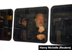 U.K. -- WikiLeaks founder Julian Assange is seen in a police van after was arrested by British police outside the Ecuadorian embassy in London, Britain April 11, 2019.