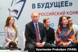 RUSSIA -- Russian President Vladimir Putin meets with students, authors of the best essays on a topic 'Russia Focused on the Future' in Moscow, January 11, 2018