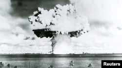 A 63-kiloton nuclear warhead explodes 90 feet under water at Bikini Atoll in July 1946 as part of Operation Crossroads to measure nuclear weapon effects on warships.