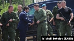 """UKRAINE – Denis Pushilin (2nd L front), representative of """"DPR"""", and Alexander Zakharchenko (2nd R front), head of the """"DPR"""", attend the commemorative events in memory of the people, who died during Boeing 777 crash on 17 July 2014."""