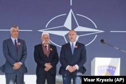 KOSOVO -- Kosovar Prime Minister Ramush Haradinaj, right, Rifat Jashari family member of the Jashari family and Kosovar President Hashim Thaci, left, attend the 20th anniversary of the NATO bombing in the village of Glogjan, March 24, 2019