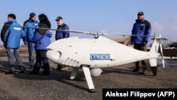 UKRAINE -- Members of the Organization for OSCE Observer Mission, Special Monitoring Mission in Ukraine, arrive for the test flight of the unmanned aerial vehicle Camcopter S-100 along the eastern front line near the village of Stepanivka in the Donetsk, March 28, 2018.