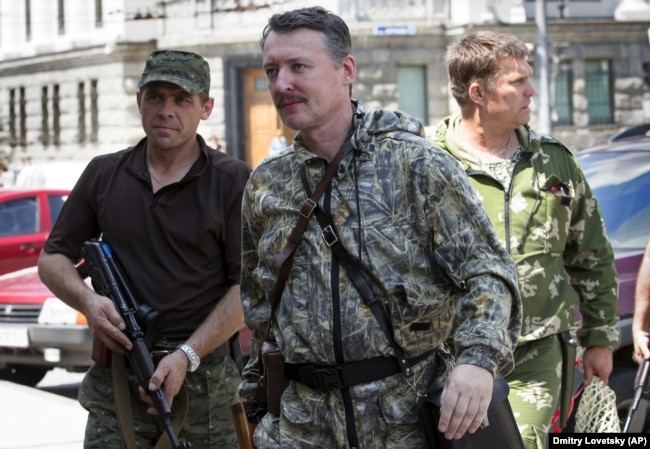 UKRAINE – Igor Girkin (center), also known as Igor Strelkov, a Russian citizen and commander of Kremlin proxy forces in Ukraine in the city of Donetsk, July 11, 2014