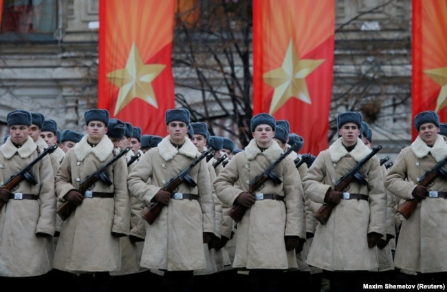 RUSSIA -- Russian servicemen dressed in historical uniforms wait before a military parade at Red Square in Moscow, Russia November 7, 2017.