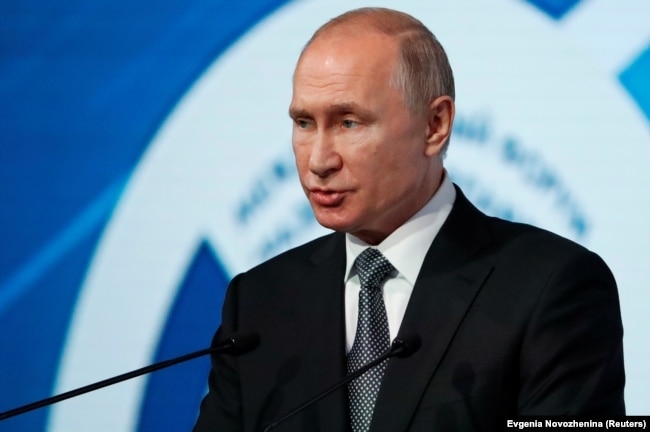 """RUSSIA -- Russian President Vladimir Putin delivers a speech during the International Forum """"Development Of Parliamentarism"""" in Moscow, Russia July 3, 2019."""