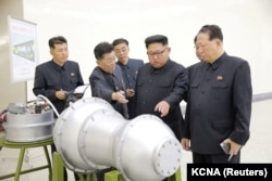 North Korean leader Kim Jong-Un examines what could be a thermonuclear warhead. Image is provided by the Korean Central News Agency in Pyongyang on September 3, 2017 and is not verified.