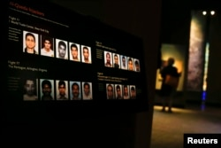 U.S. -- Pictures of the September 11th hijackers are seen inside the National September 11 Memorial & Museum during a press preview in New York May 14, 2014.
