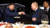 RUSSIA -- Russian President Vladimir Putin and Chinese President Xi Jinping toast during a visit to the Far East Street exhibition on the sidelines of the Eastern Economic Forum in Vladivostok, September 11, 2018