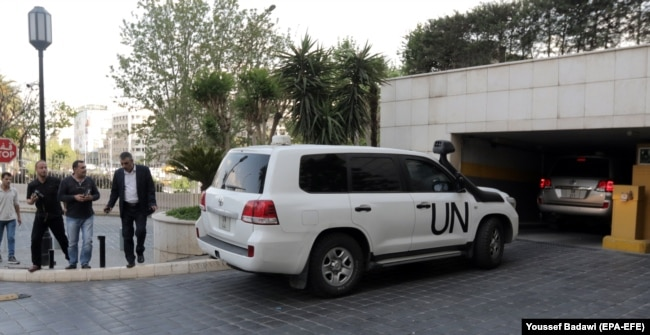 SYRIA -- UN vehicles carrying Fact-Finding Mission (FFM) team of the Organization for the Prohibition of Chemical Weapons (OPCW) arrive at the Four Seasons hotel in Damascus, April 14, 2018