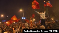 Macedonia - President of pro-Russian party, United Macedonia, Janko Bachev, waves the Macedonian and Russian flags as police desperse demonstrators against the Macedonia name change in front of the Parliament in Skpoje, June 17, 2018