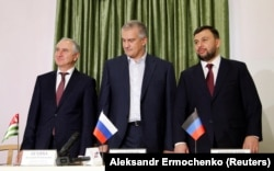 UKRAINE -- (E-L) Denis Pushilin, newly elected head of the separatists in the Donetsk region, head of Crimea Sergei Aksyonov and prime minister of Georgia's breakaway region of Abkhazia Valery Bganba attend an inauguration ceremony in Donetsk, November 20.