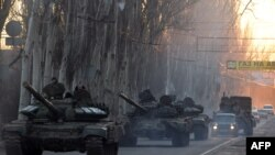 Ukraine - Pro-Russian separatists patrol a street in the eastern Ukrainian city of Makeyevka on February 18, 2015.