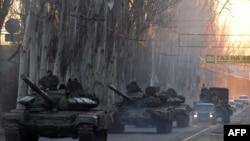 Ukraine - Pro-Russian separatists patrol a street in the eastern Ukrainian city of Makeyevka on February 18, 2015.