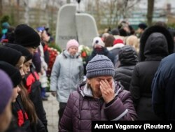 RUSSIA -- A woman cries at an opening ceremony of a monument commemorating victims of the crash of Metrojet Airbus A321 in Egypt's Sinai peninsula in 2015, in St. Petersburg, Russia October 28, 2017