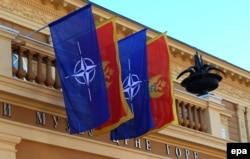 Montenegro -- Flags of NATO and Montenegro fly on the Goverment House building, in Cetinje, December 3, 2015