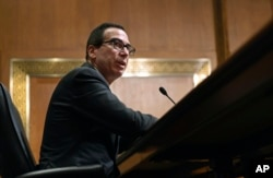 U.S. Treasury Secretary Steven Mnuchin testifies on Russia and economic sanctions before the Senate Finance Committee on Capitol Hill in Washington, February 14, 2018.
