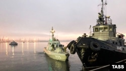 "UKRAINE - Three ships of the Naval Forces of Ukraine artillery boats ""Nikopol"", ""Berdyansk"" and raid tug ""Yani Kapu"" (from left to right), towed to the city port, on November 26, 2018."