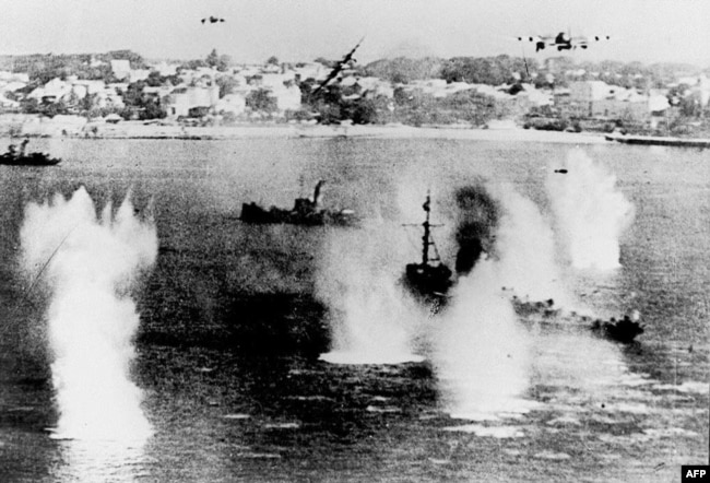 FRANCE -- In this file photo taken on June 06, 1944 Allied ships are attacked by German fighters as the largest massed assault of World War II begins to land men and supplies on the coast of northern France.