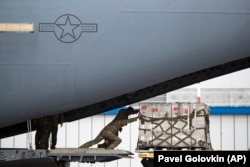 U.S soldiers unload medical aid from the United States, including ventilators as a donation to help Russia tackle the coronavirus outbreak, after a U.S. air force plane landed at Vnukovo International Airport in Moscow, June 4, 2020.