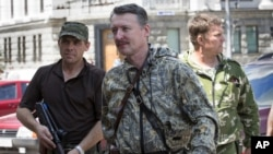 UKRAINE – Igor Girkin also known as Igor Strelkov, a pro-Russian commander, center, arrives for the wedding of platoon commander Arsen Pavlov and Elena Kolenkina in the city of Donetsk, eastern Ukraine. July 11, 2014